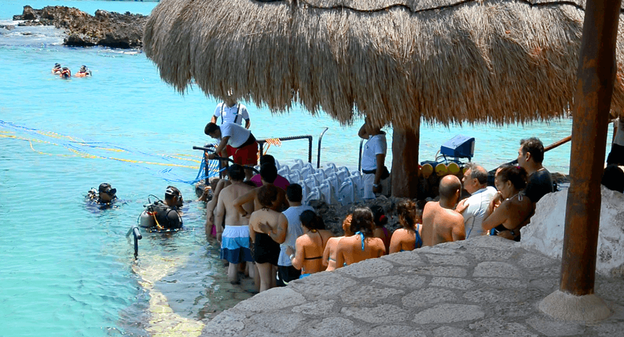 sea trekkers in line to get in the water